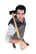 Man carrying sledge-hammer