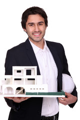 Architect holding scale model of housing