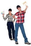 Two female decorators choosing paint color