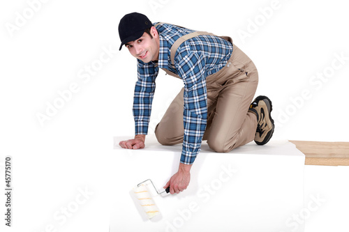 Painter painting a rectangular structure