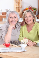 Mature women playing chess