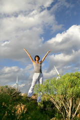 Woman stood in wind farm