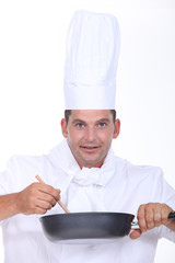 Chef stirring pan