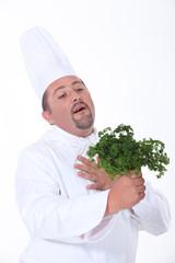 Chef loving parsley.