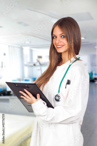 Attractive blonde doctor with a folder