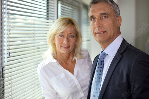 Senior business couple at work