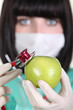 Medic using a stethoscope on an apple