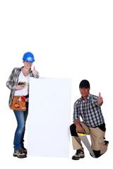 Thumbs up from carpenters with a blank board