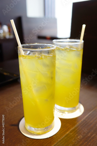 two cold iced green tea with straws