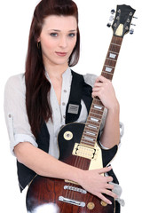 Young brown-haired woman holding guitar