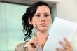 secretary holding a notepad