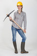 Woman posing with pick-ax
