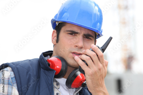 craftsman using a talkie-walkie