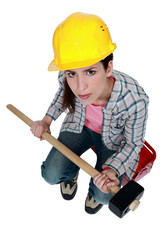 female builder holding a sledge hammer