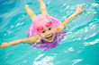 little girl swimming