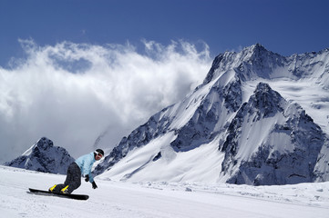 Snowboarder on piste slope