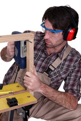 Man building a wooden frame