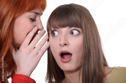 Two women gossiping