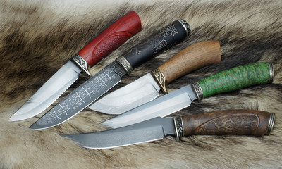 knifes on a skin of a raccoon