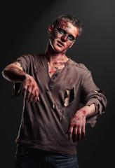 The boy is zombie in the studio