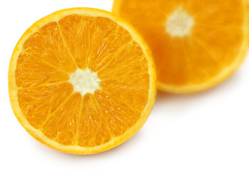 Sliced oranges with selective focus over white background