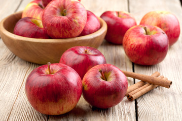 Red apples in a wooden bowl on the table