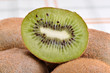Kiwi fruit on a table top.