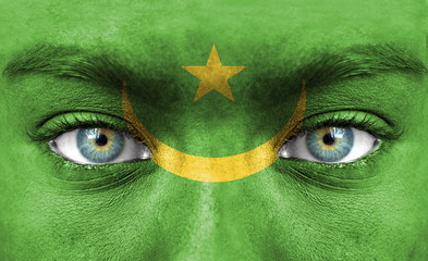 Human face painted with flag of Mauritania