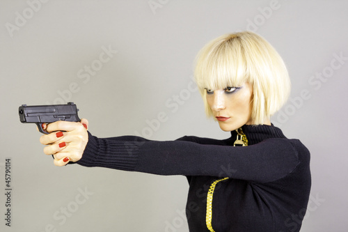 Blond sexy girl with gun