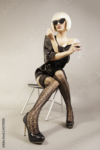 Attractive blond girl with glass of red wine