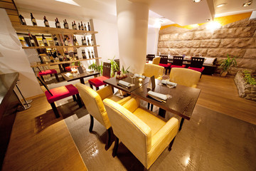 Hall with leather chairs near bar in sushi restaurant
