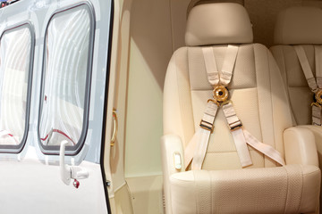 Helicopter business class interior with chairs seat belts