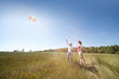Husband, wife launch kite in field
