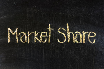 MARKET SHARE handwritten with chalk  on a blackboard