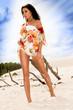 Beautifull caucasian girl walking on the beach