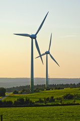 Wind turbines in a forest and meadow landscape