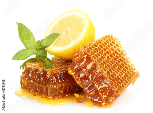 sweet honeycombs with lemon and mint, isolated on white