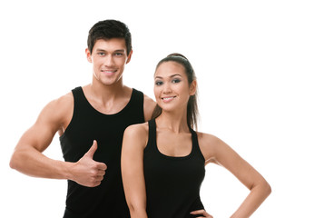 Two positive sportive people in black sportswear