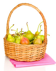 ripe pears in basket isolated on white.