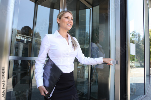 Business Woman Leaving Building