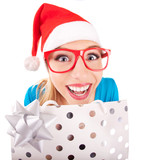 Funny santa girl giving a present