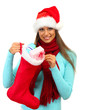beautiful young woman holding  christmas sock with gifts,