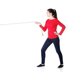 Happy casual woman pulling a rope with ease
