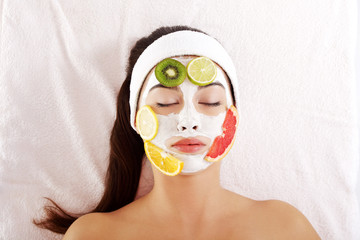 Young woman with fruit mask on a face