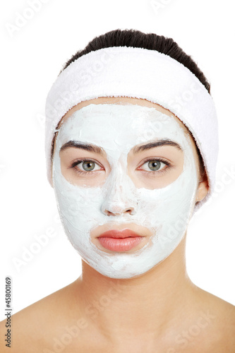 Beautiful woman with clay face mask