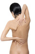 Young woman with pain in her back.