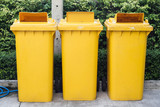 yellow garbage bins