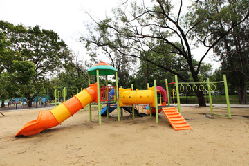 Complex playground set in well-maintained park