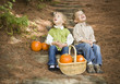 Brother and Sister Children on Wood Steps with Pumpkins Singing