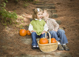 Fototapety Brother and Sister Children on Wood Steps with Pumpkins Whisperi